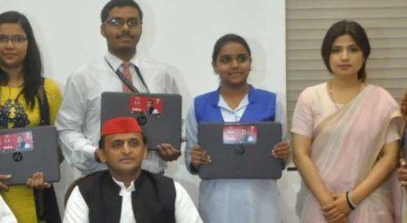 Akhilesh distributes laptops to scholars in UP, slams BJP
